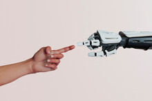 Human And Robot Hands Touch Fingers