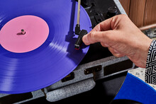 Man Playing A Disc In A Turntable