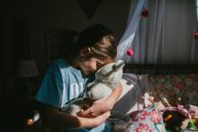Child Affectionately Holds Stuffed Animal