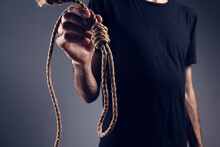 Man Holding A Noose. Suicide Concept. On Gray Background