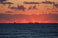 Barges And Tug On The Horizon Of The Ocean
