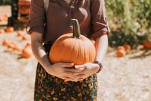 Closeup Of Woman Holding Pumpkin