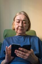 Senior Woman Texting On Phone