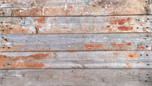 Texture Of Wall Made Of Nailed Wooden Planks Covered With Old Peeled Paint And Heavily Cracked