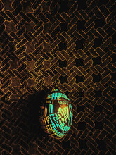 Happy Easter Egg On A Dark Intricate Fabric Pattern Background