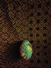 Rainbow DIY Easter Egg On A Dark Pattern Background