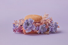 Closeup Of Burger With Violet Flowers
