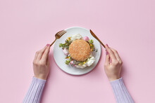 Woman Eating Burger With Peonies