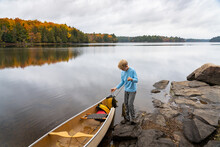 Boy With Smallmouth Bass And Canoe