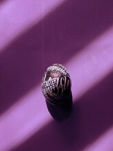 DIY Typographic Happy Easter Egg On A Purple Background With Copyspace