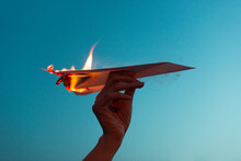 Holding A Burning Paper Plane