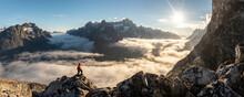 Tourist Exploring Mountains In Morning