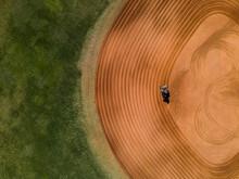 A Tractor Rakes A Baseball Field Aerial View