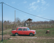 Countryside Landscape With An Old Car And A Villa