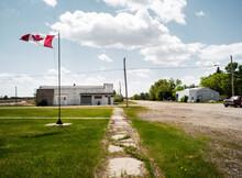 A Canadian Flag Flies On The Main Street.
