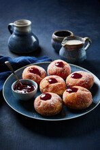 Raspberry Jelly Filled Donuts With Creamer And Pitchers