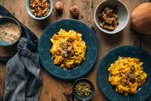 Top View Of Pumpkin Risotto Topped With Sauteed Mushrooms