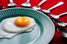 Scrambled Eggs On A Blue Plate.