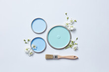 Blue Lids Of Paints And Flowers