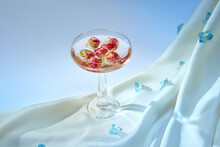 Closeup Of Drink With Blossoming Roses In Ice Cubes
