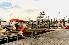 A Colorful Array Of Boats Docked At The Marina.