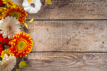 Cozy Autumn Background With With Colorful Flowers, Red Yellow Leaves, White Pumpkins And Warm Plaid, Sweater On Rustic Wooden Background. Fall, Thanksgiving Day Concept. Flat Lay, Top View, Copy Space