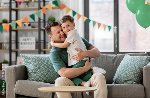 family, fatherhood and people concept - portrait of happy smiling father and lit Fototapeta