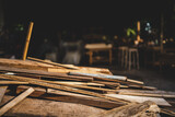 Fototapeta Na ścianę - Background image of furniture woodworking workshop, carpenters industrial wooden material work table with different craft tools and wood cutting stand, vintage filter image.