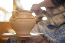 The Craftsman Makes Pottery. A Potter Makes A Clay Jug By Hand.
