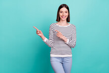 Photo Of Promoter Lady Indicate Forefingers Empty Space Wear Striped Shirt Isolated On Teal Color Background