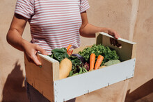 Fresh Fruits And Vegetables In Reusable Bags On Kitchen Table