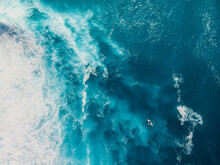 Blue Ocean With Waves And Foam. Aerial View With Surfer And Sea