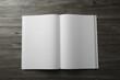 Leinwandbild Motiv Open blank paper brochure on wooden table, top view. Mockup for design