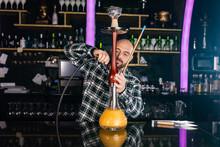Man Preparing Hookah At Night Club