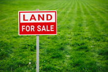 Land For Sale Plate Sign, Green Lawn Background