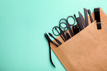 Manicure Set In Paper Bag On Turquoise Background, Top View. Space For Text