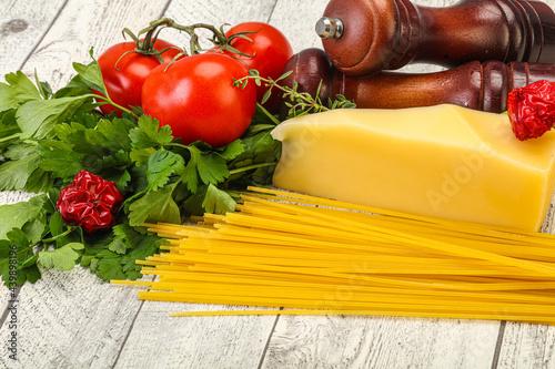 Fototapeta Raw Italian spaghetti heap with cheese