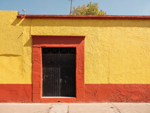A Yellow And Red House In Mexico
