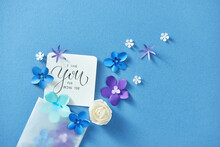 Love Letter With Flowers On Blue