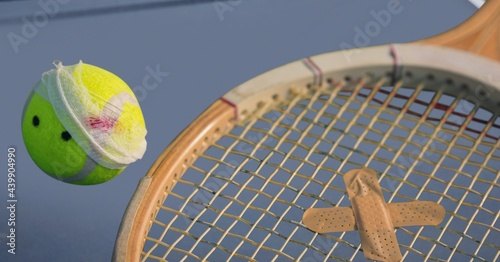 Composition of tennis ball and racket with plaster on tennis court