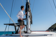 Man With Rope Standing Near Mast On Yacht