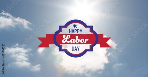 Happy labor day text and tool icons against clouds in blue sky
