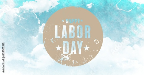 Happy labor day text over round banner against grunge effect over clouds in blue sky