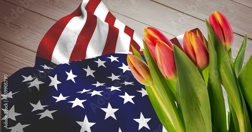 American flag and pink red tulip flowers on wooden background