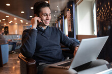 Content Man Working Remotely On Cruise Ship