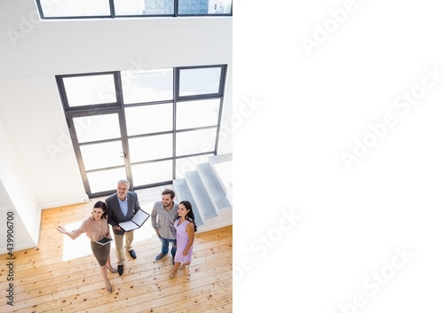Composition of real estate agents showing couple sunny modern property
