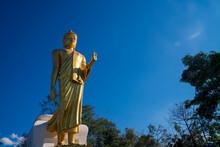 Phu Khok Ngio Standing Golden Big Buddha With Blue Sky Background In Sunny Day At Chiang Khan District Loei Thailand, Chiang Khan Skywalk Of Phu Phra Yai Travel Landmark