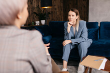 Woman Listening To Psychotherapist During Appointment