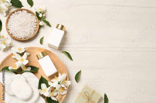 Obraz na plátně Flat lay composition with spa stones and beautiful jasmine flowers on white wood