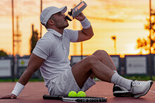 Young Man On Tennis Court